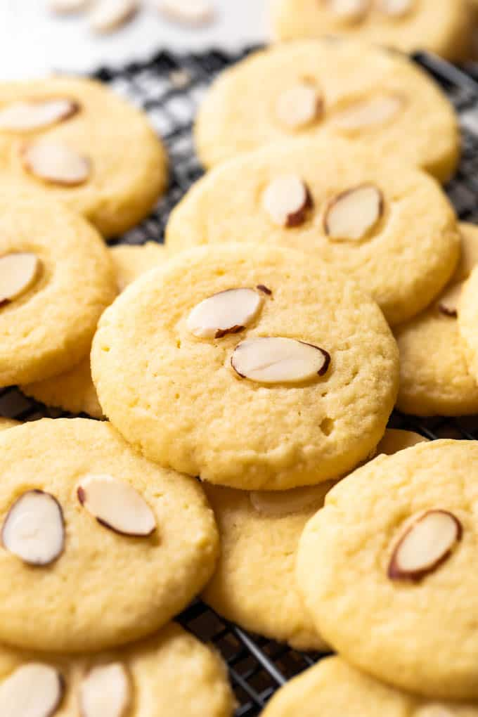Almond cookies on a cookie rack.