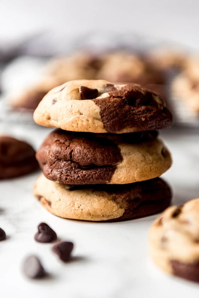 A stack of three chocolate and chocolate chip cookies.