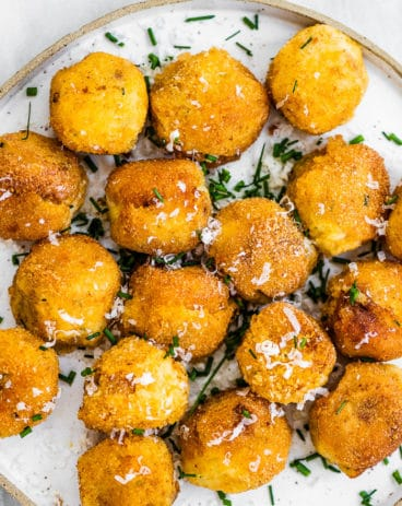 Mashed potato balls on a white plate.