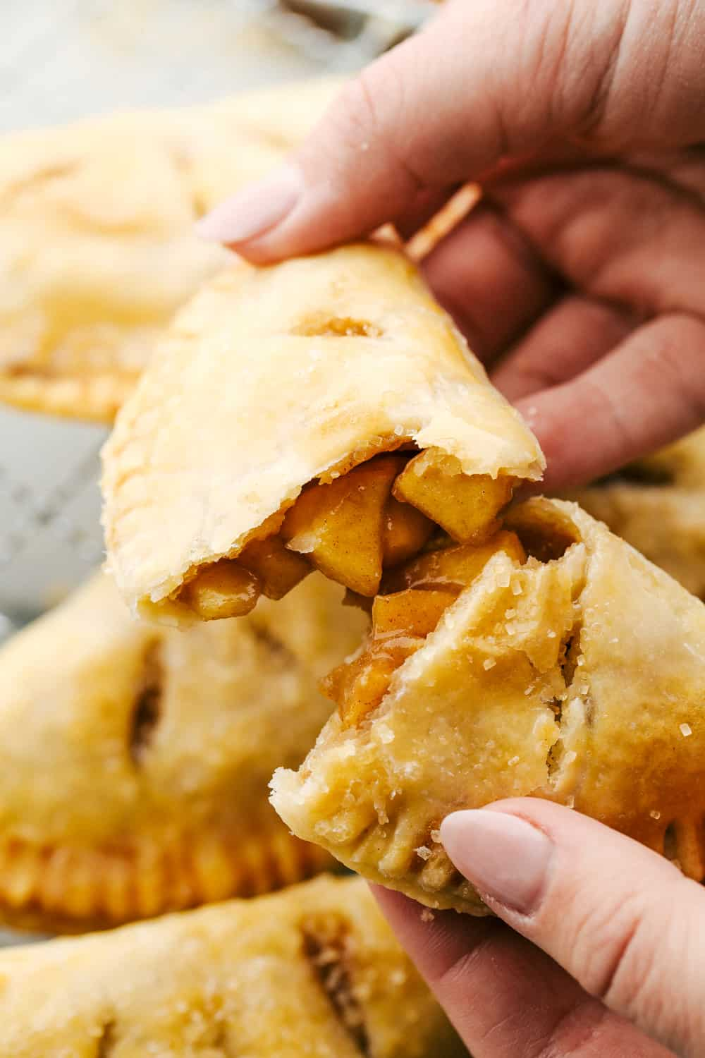 Breaking a hand held pie exposing the amazing filling.
