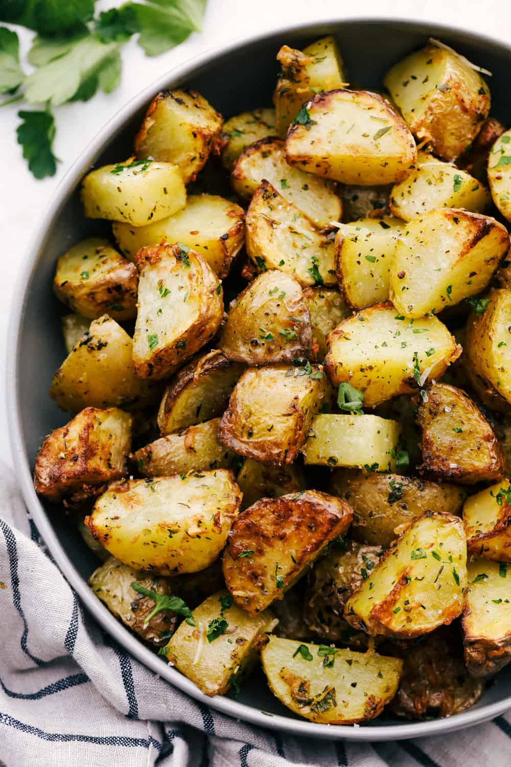 Herb crusted and perfectly seasoned air fryer roasted potatoes.