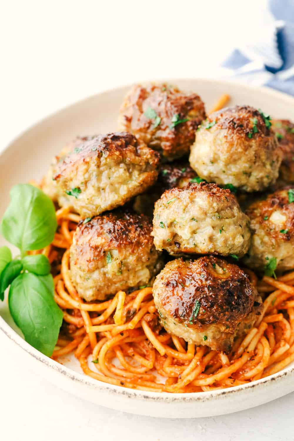 Perfectly baked turkey meatballs with spaghetti noodles and sauce.