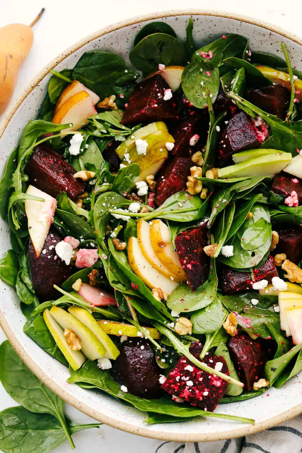 Pears and roasted beets in a bed of greens with walnuts and feta.