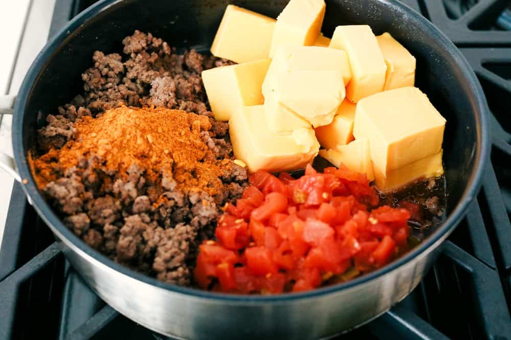 Mixing hamburger, cheese, spices and tomatoes for an amazing dip.