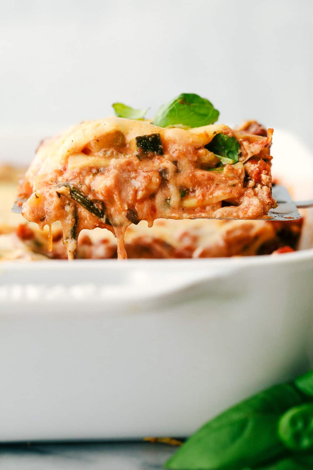 Vegetable Lasagna being scooped out of the dish.