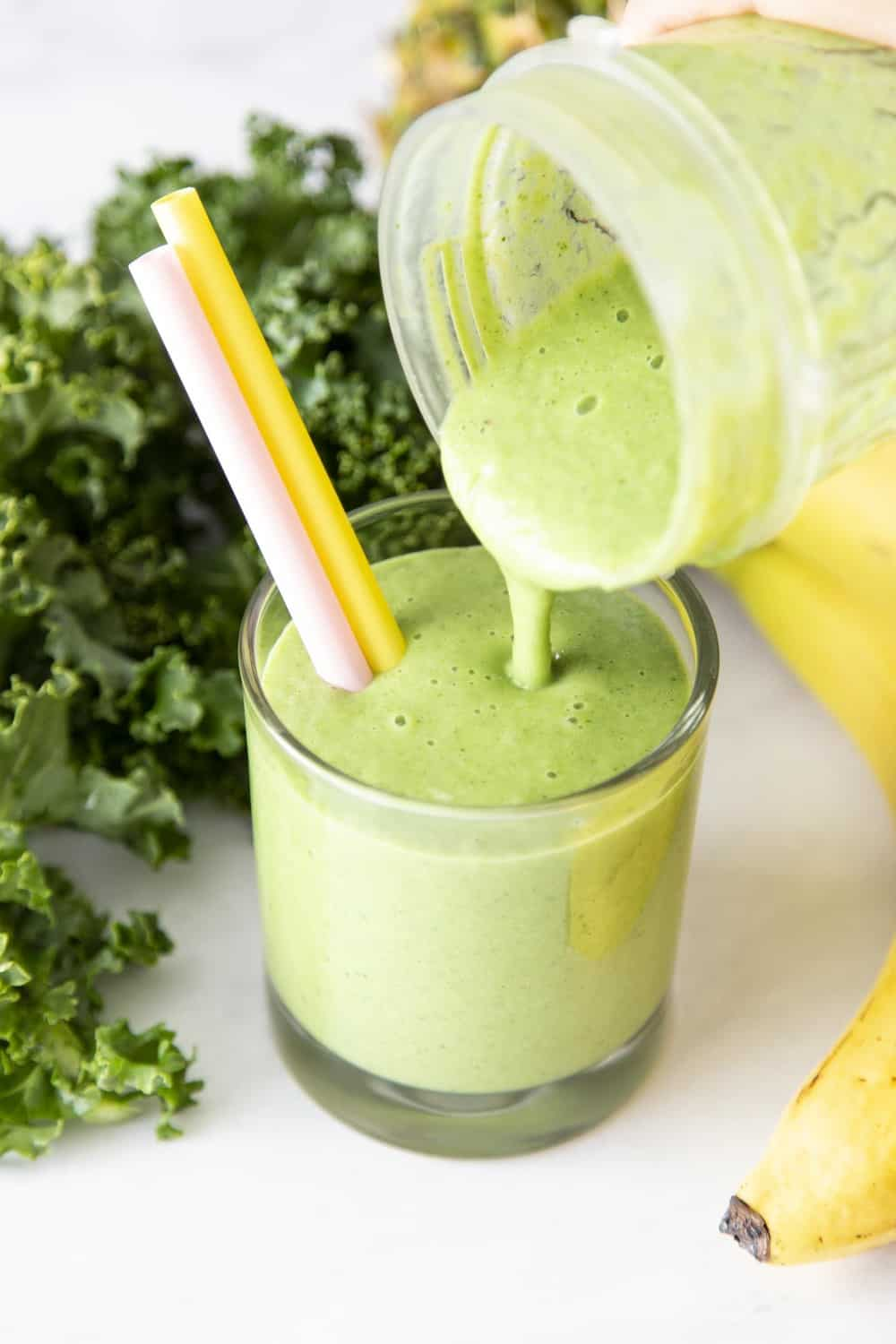 Kale smoothie being poured into a glass