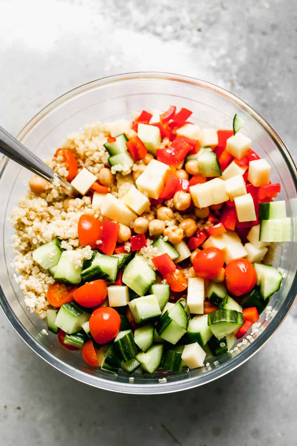 Packed with fuffy quinoa, crisp veggies, chickpeas, salty provolone cheese, and a zesty lemon vinaigrette, this easy Quinoa Salad is the perfect lunch on its own, or base for chicken, salmon or steak for dinner. 30 minutes and done!