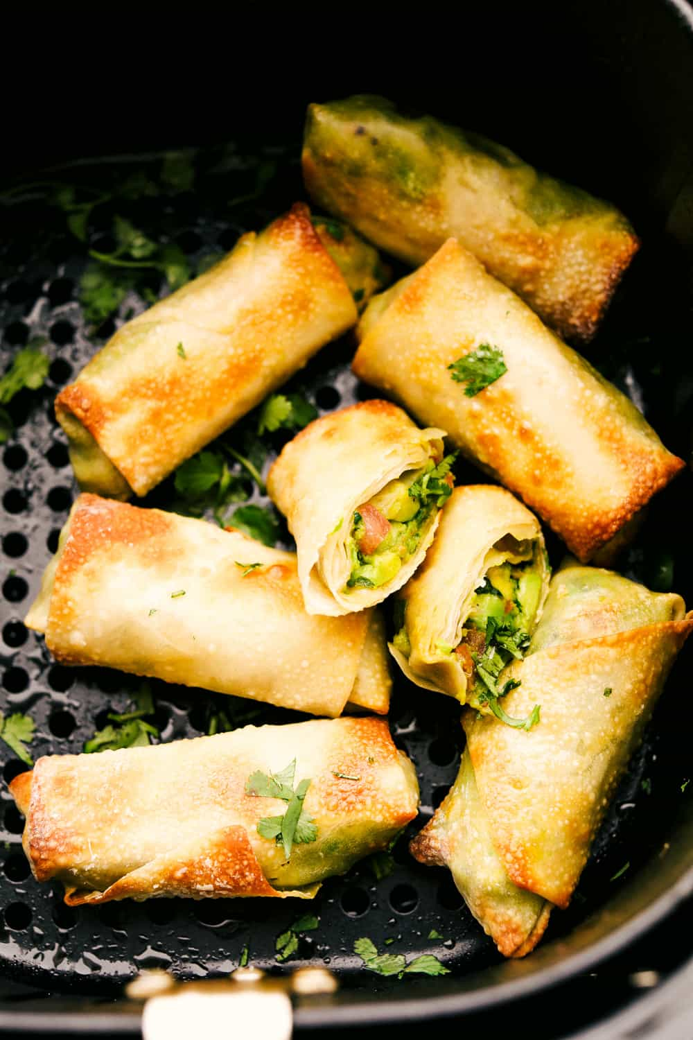 Crispy air fryer avocado egg rolls in the air fryer.