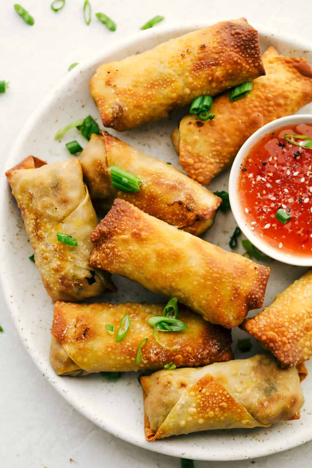 Air Fryer Egg Rolls on a platter with dipping sauce.