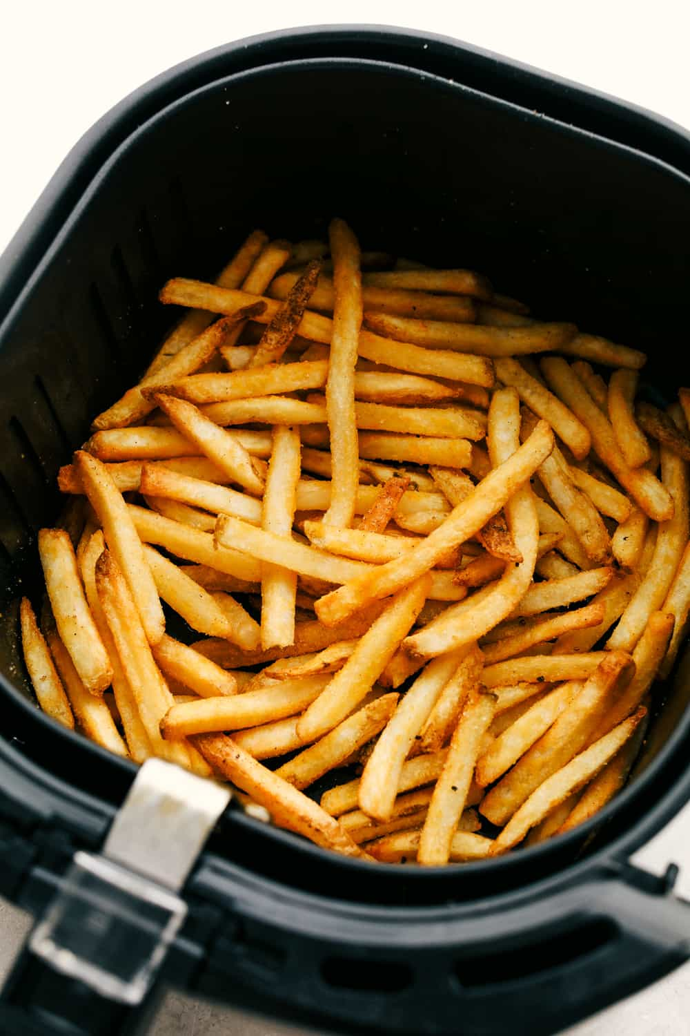 Frozen French Fries cooked in the air fryer.
