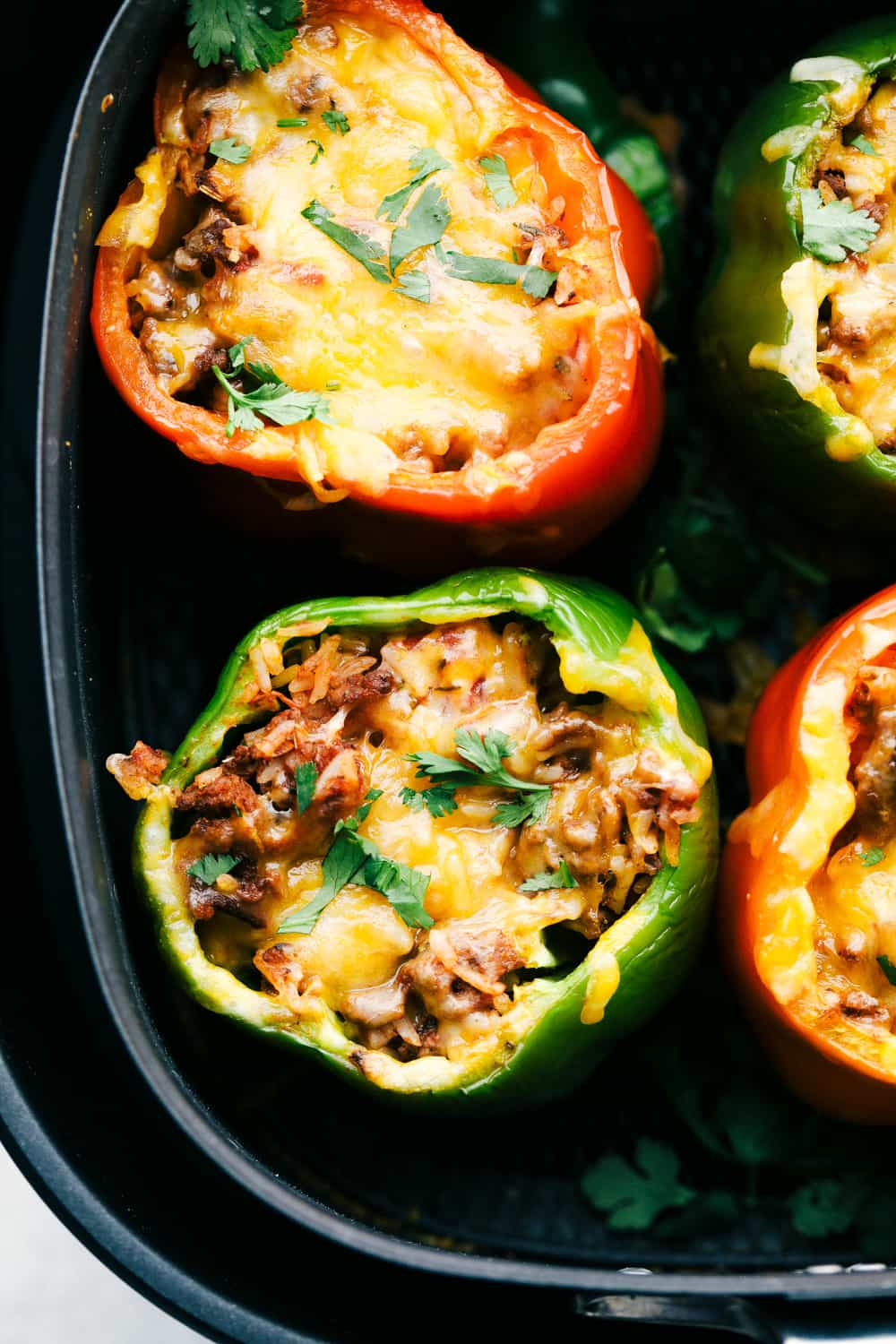 Air Fryer Stuffed peppers with cheesy rice filling.