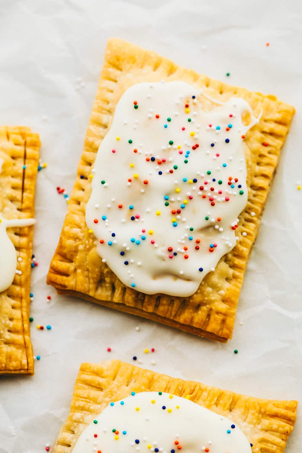Strawberry homemade pop tart with frosting and sprinkles.