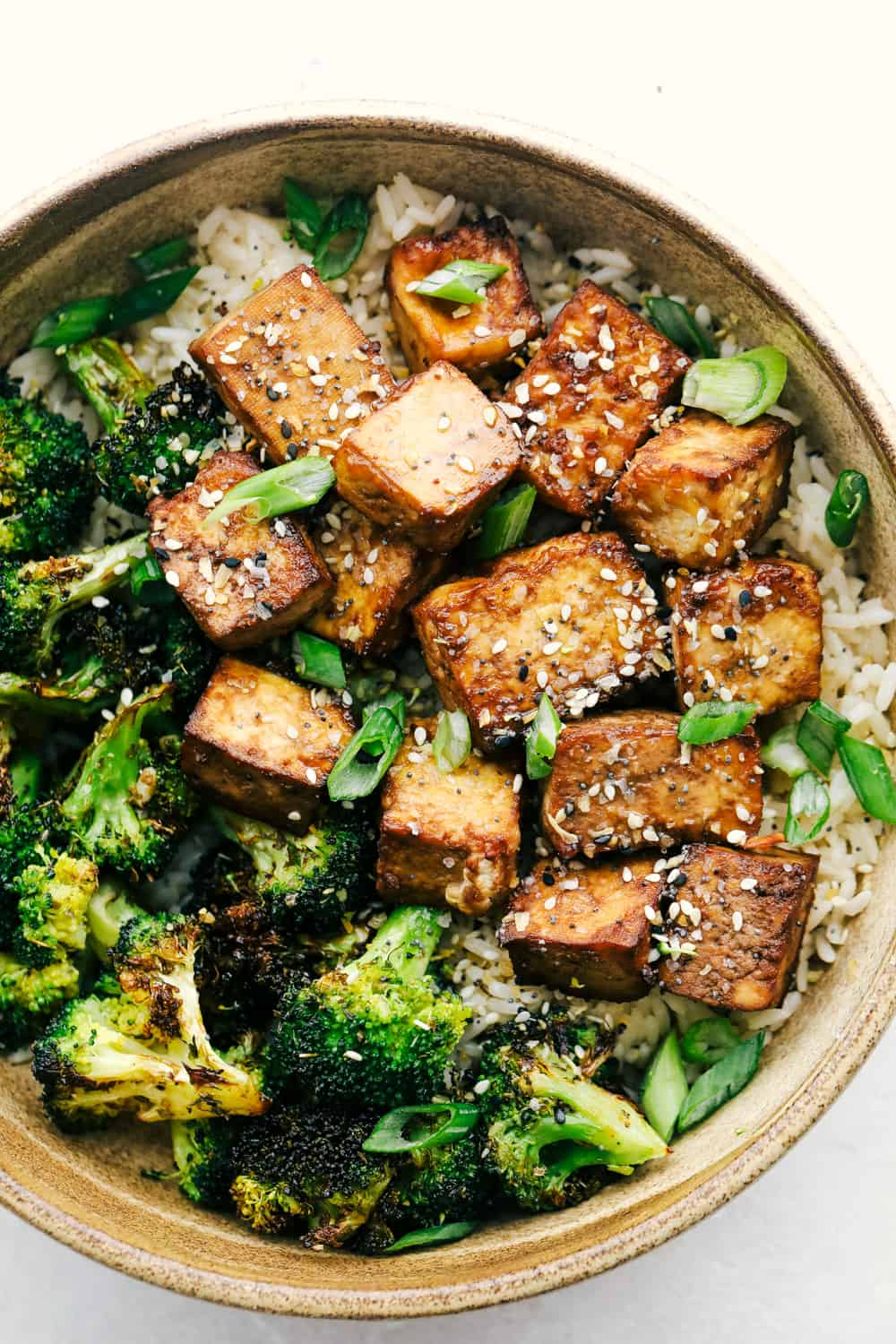 Air fryer tofu in a bowl of rice and broccoli.