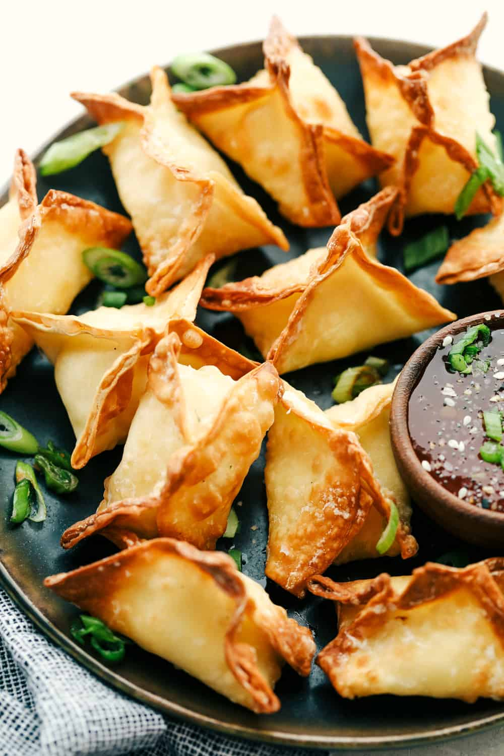 Air fryer wontons on a plate close up.