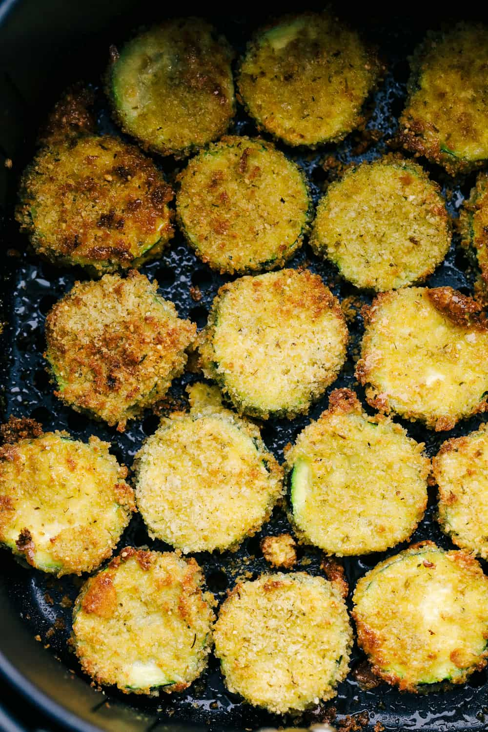 Air Fryer Zucchini chips in the air fryer.