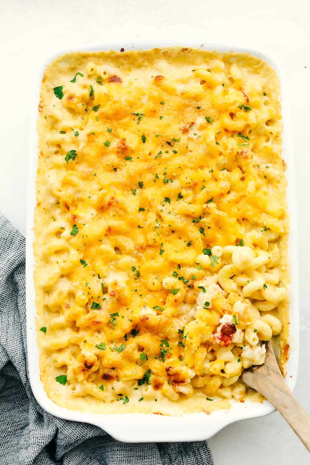 Baked lobster macaroni and cheese in a white dish.