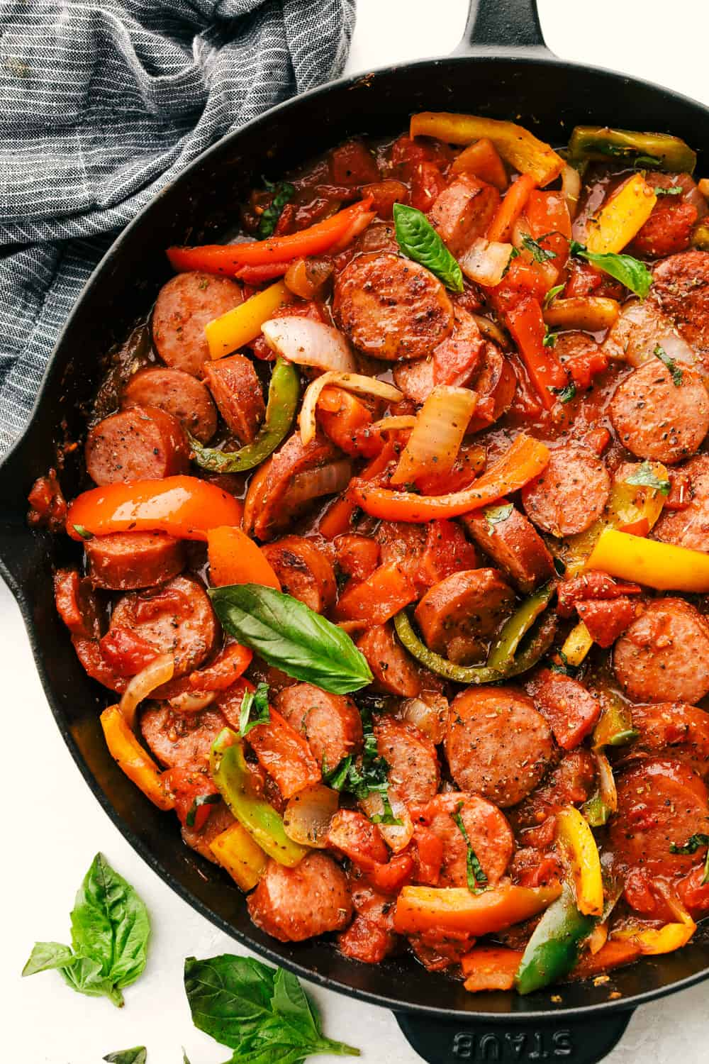 Skillet Italian sausage with peppers in a cast iron pan.
