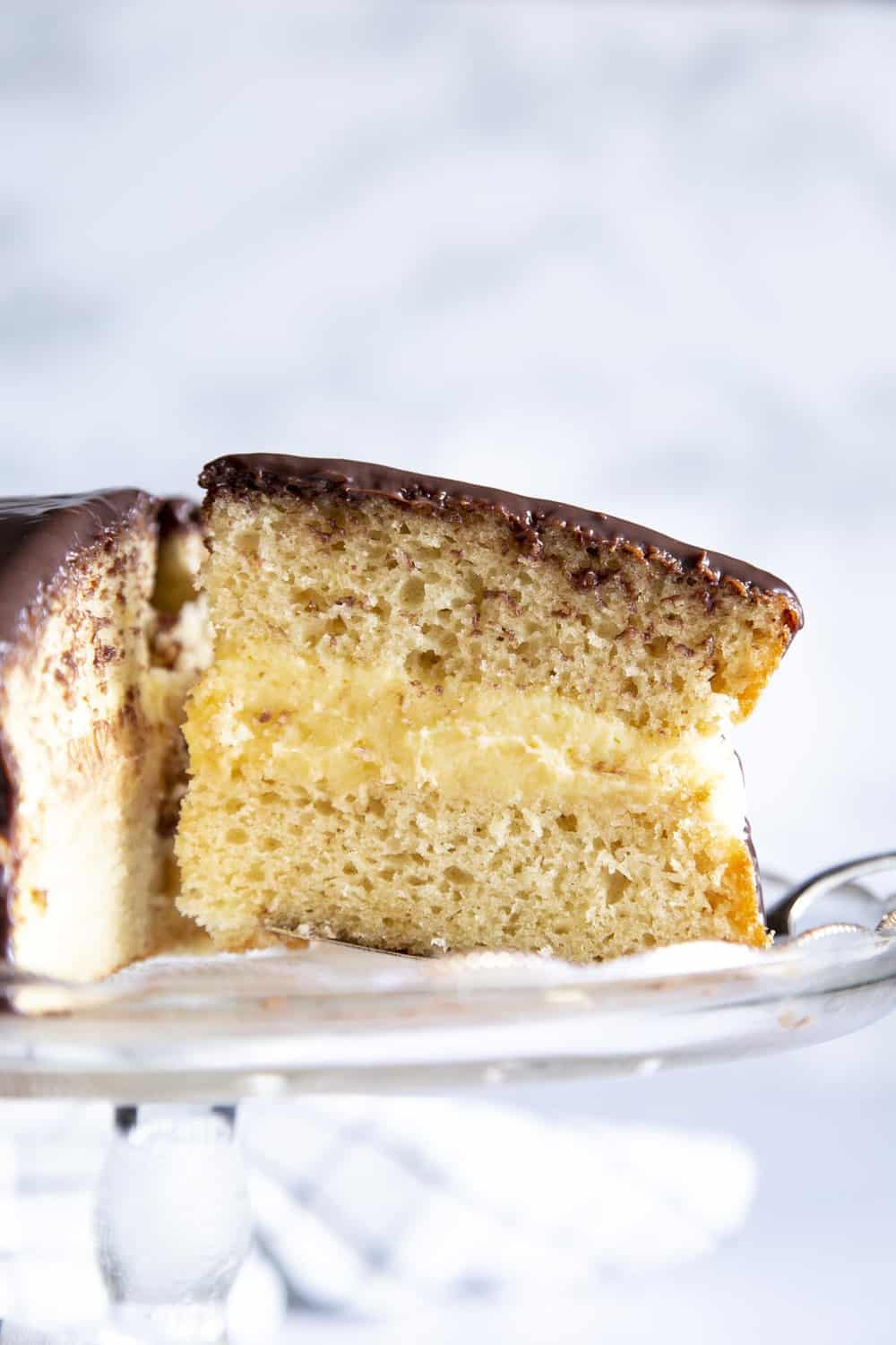 A side view of the layers in the Boston Cream Cake.