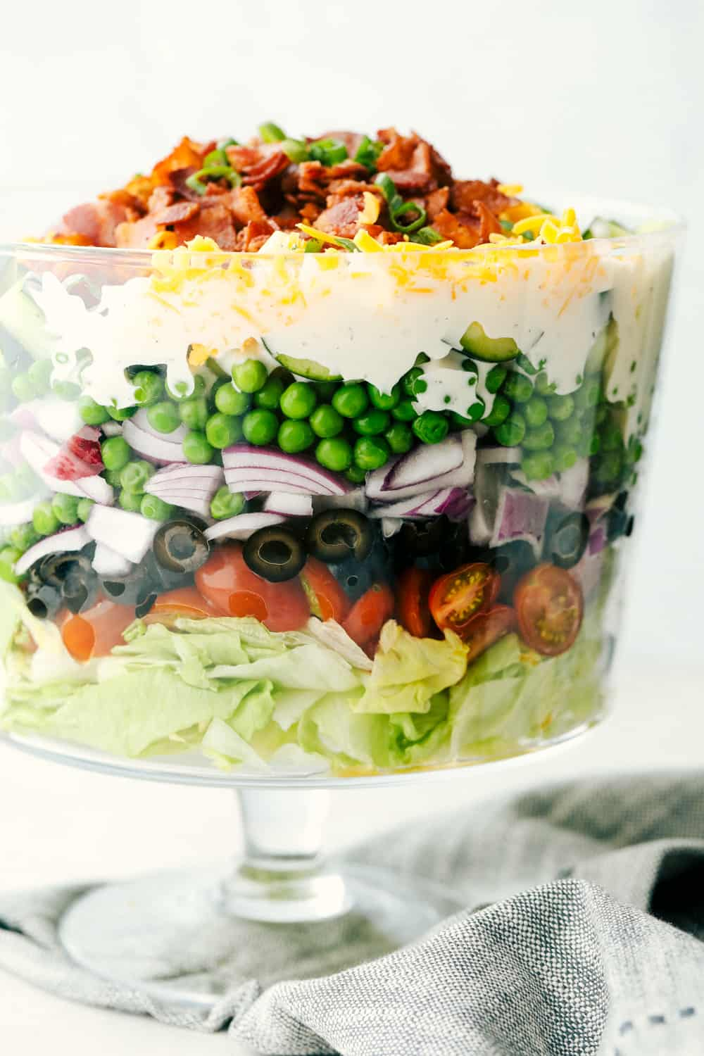 7 Layer salad with lettuce, peas and topped with bacon.