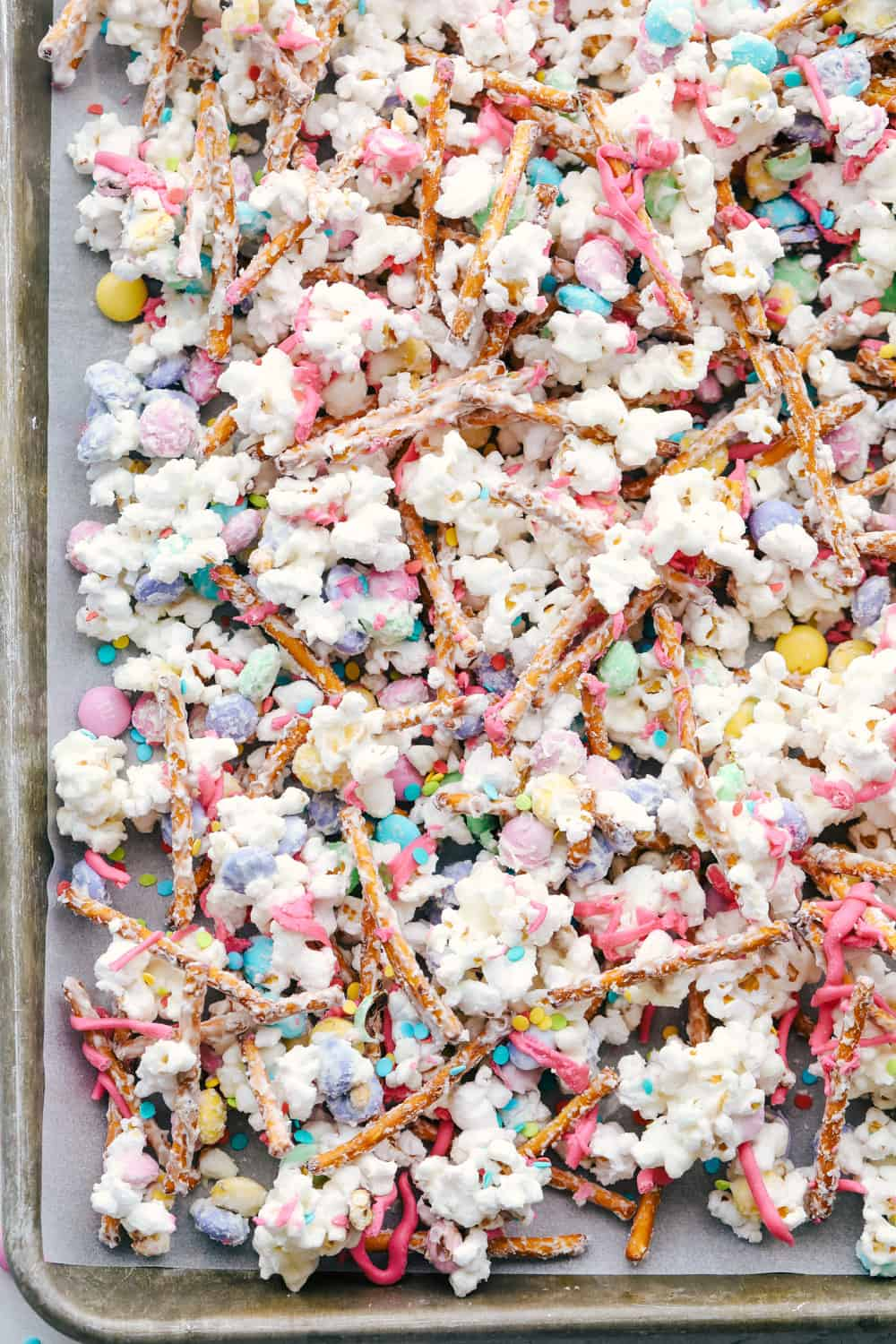 A sheet pan with colorful bunny bait cooling.