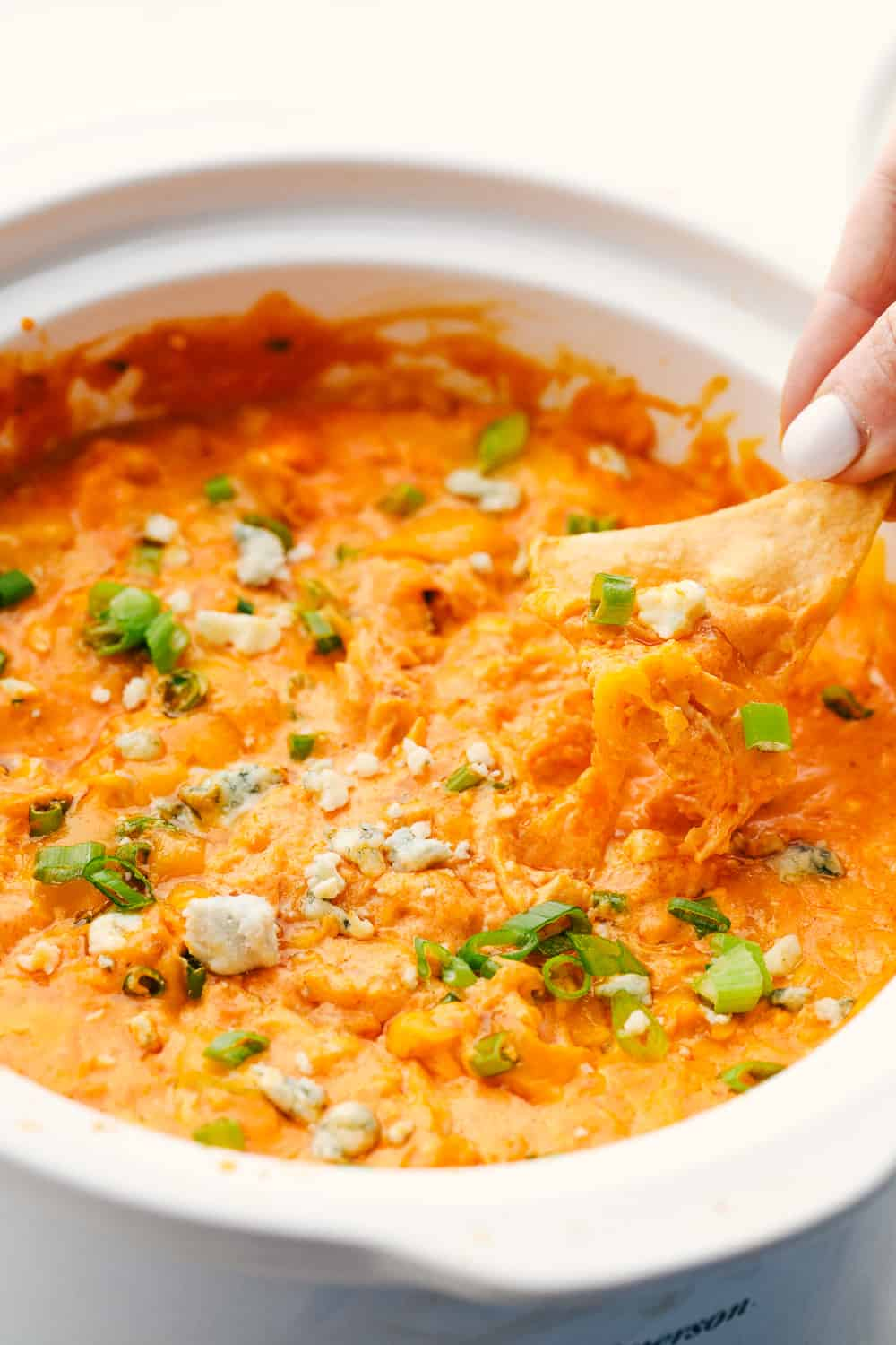 Dipping a chip into Buffalo chicken dip.