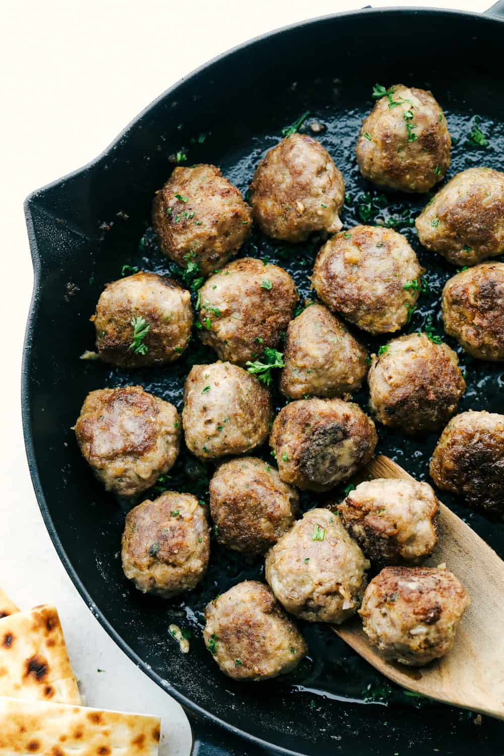 Meatballs in the skillet browned and ready to serve.