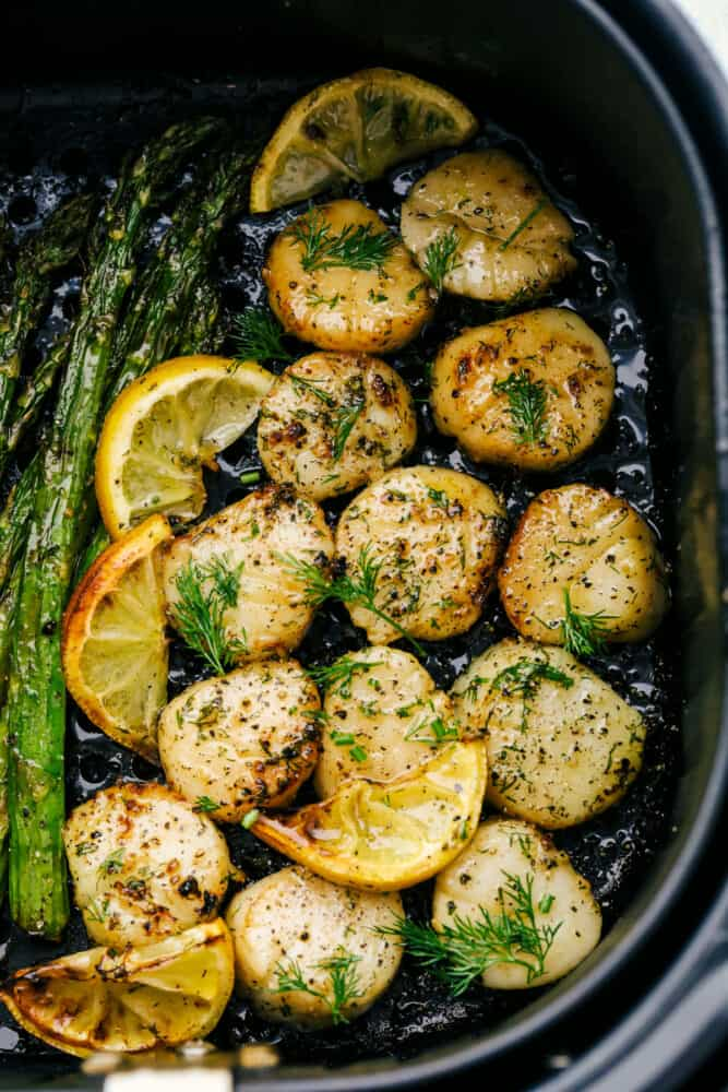 Tender scallops cooked in an air fryer with lemon and dill.