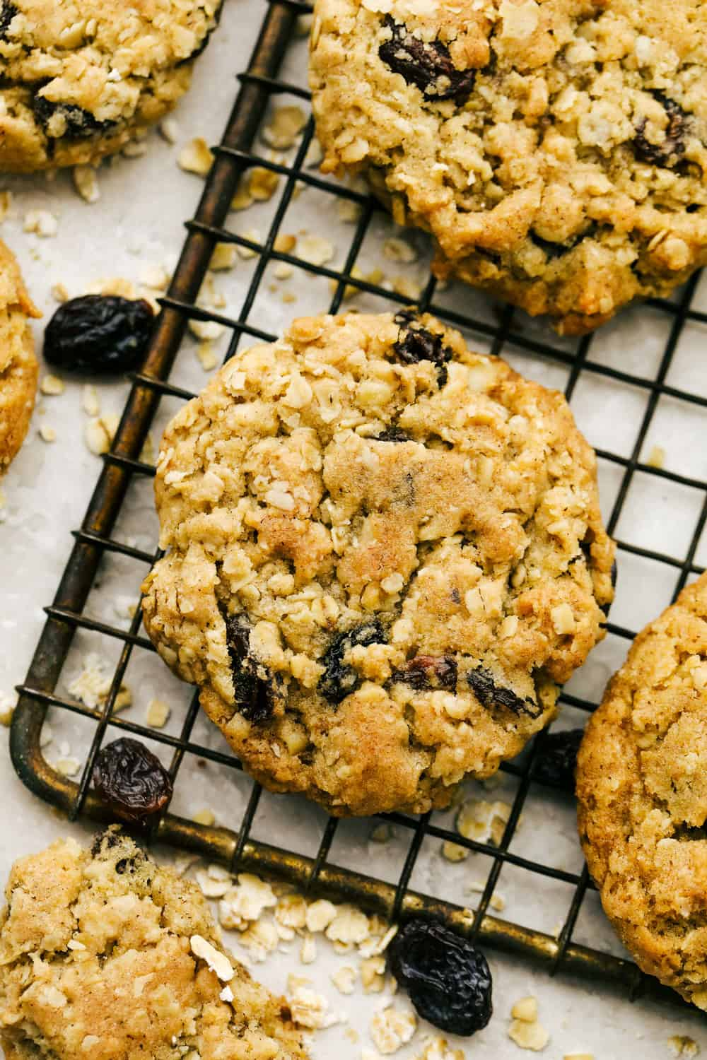 Baked oatmeal cookies on a cooling rack.