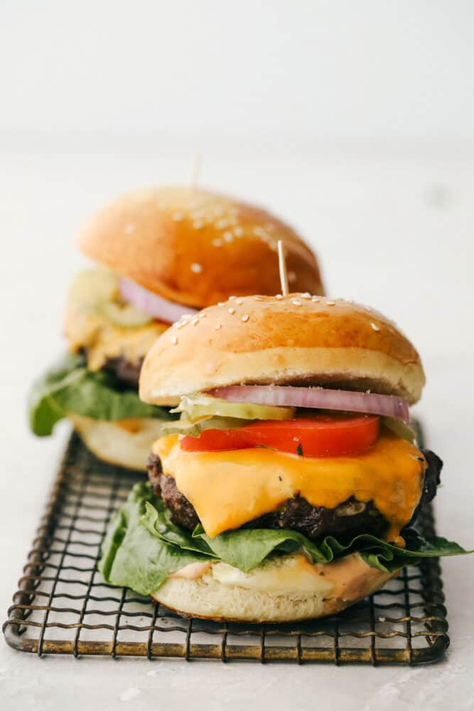 Hamburgers with all the toppings ready to be served.