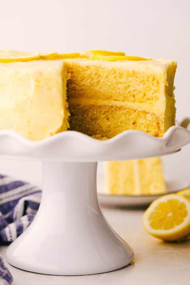 Lemon Layered Cake on a pedestal cake platter.