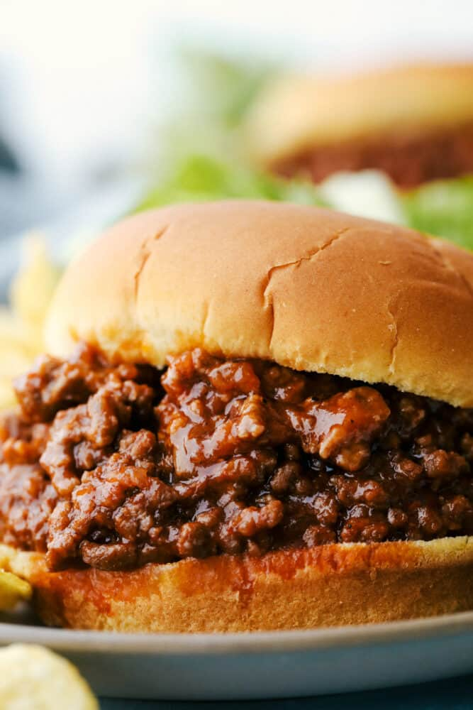 Upclose picture of a sloppy joe on  a plate.