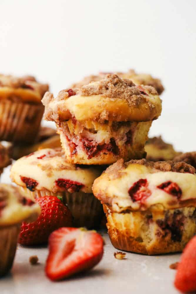 Strawberry streusel muffins stacked on top of each other.