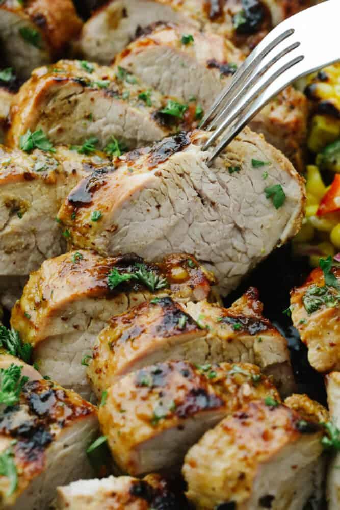 Grilled Honey Dijon Garlic Pork Tenderloin, sliced.