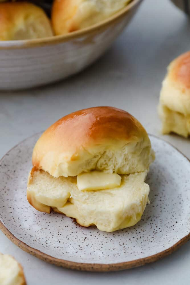 Hawaiian Roll cut in half with dollop of butter.