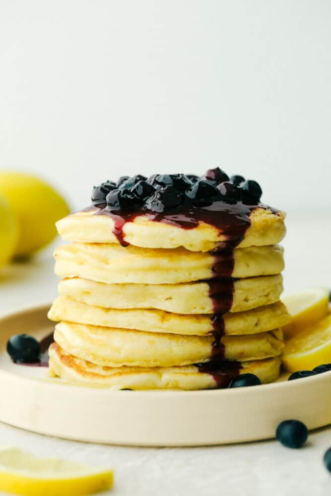 Stack of Lemon ricotta pancakes with blueberry sauce.