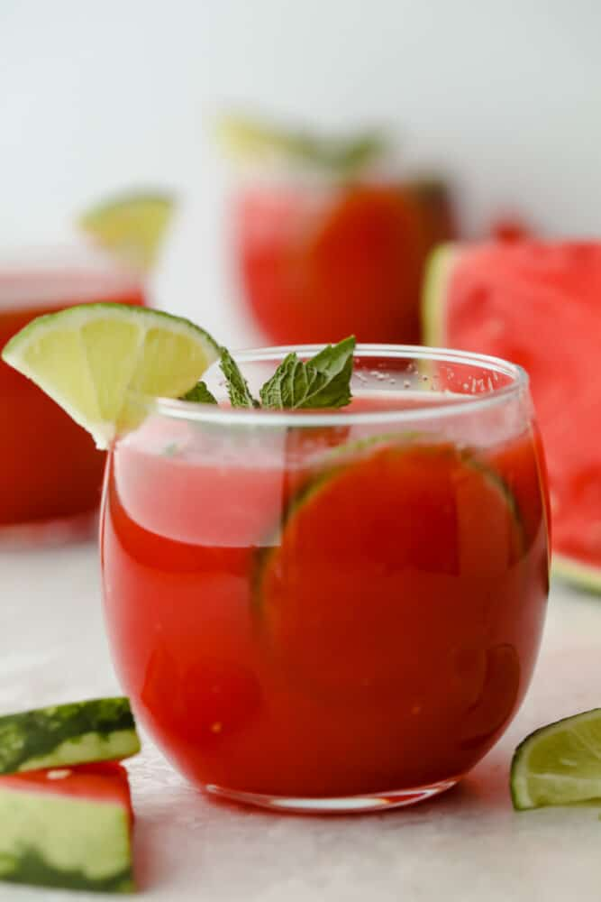 Watermelon agua fresca in cup with mint and lime garnish