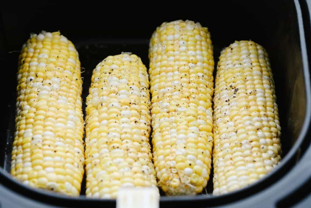 Corn on the cob in the air fryer with salt and pepper.