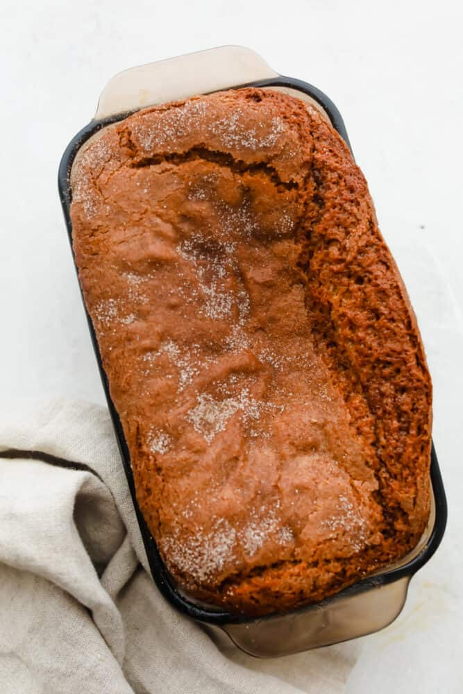 A loaf of Amish Friendship Bread, sprinkled with cinnamon sugar.