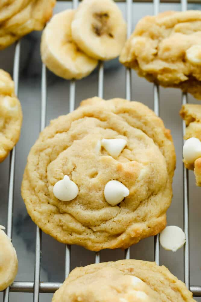 Banana cookies on a wire rack.