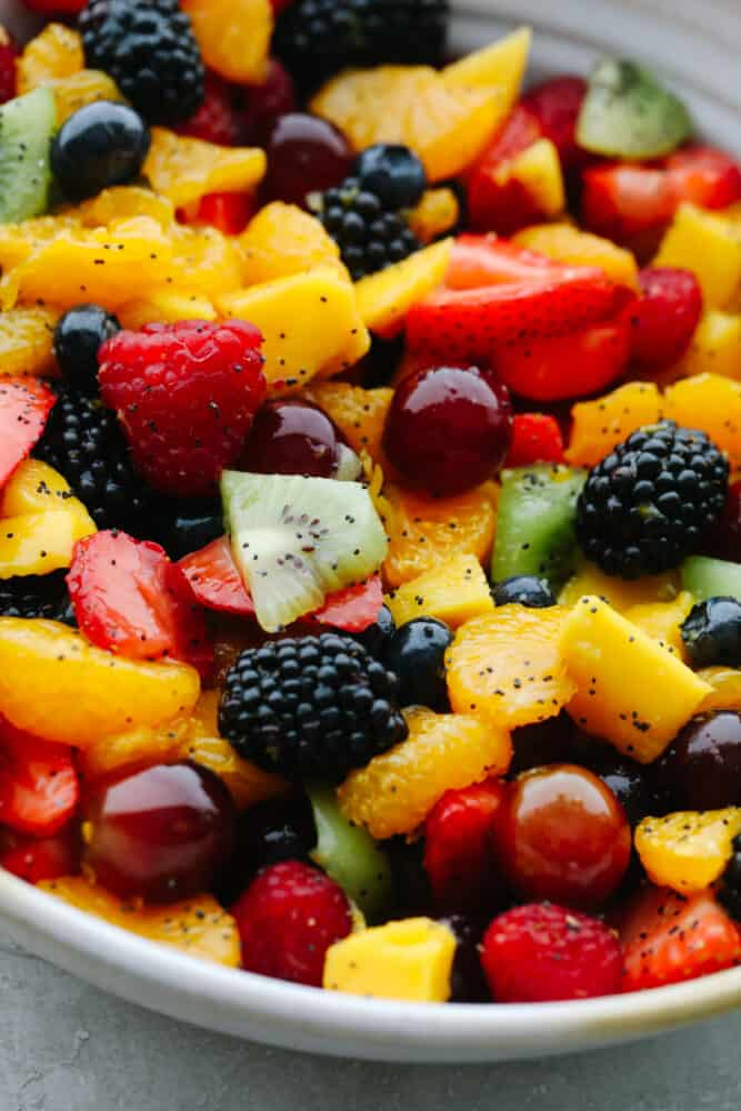 Blackberry Lime Fruit Salad with poppyseed dressing in bowl.