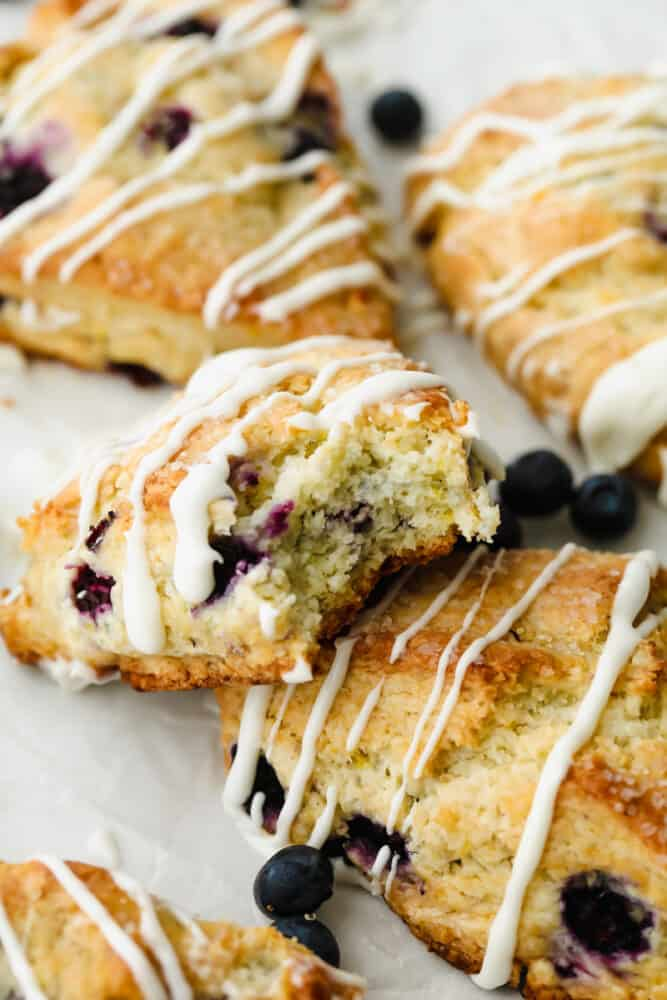 Blueberry Scone with a bite taken out of it.