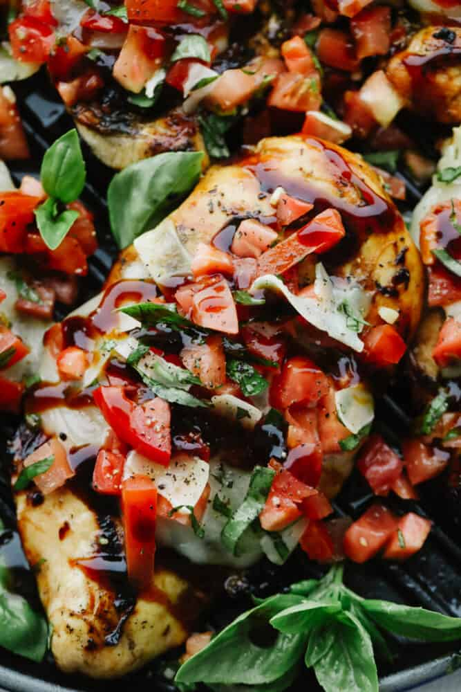 Close-up of Bruschetta Chicken and toppings.