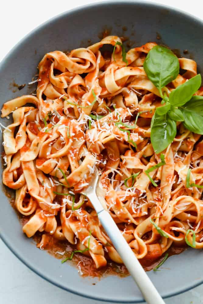 Homemade pasta tossed with marinara sauce.