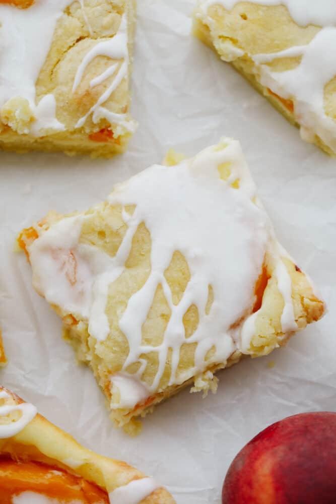 Peaches and cream pie bars cut into squares.