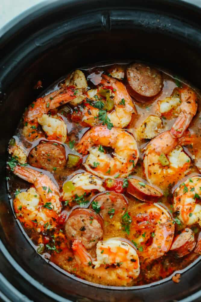 Seafood and sausage cooking in a slow cooker.