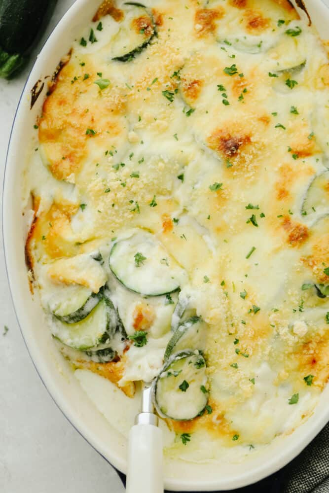 Parmesan Zucchini Gratin in a white dish.