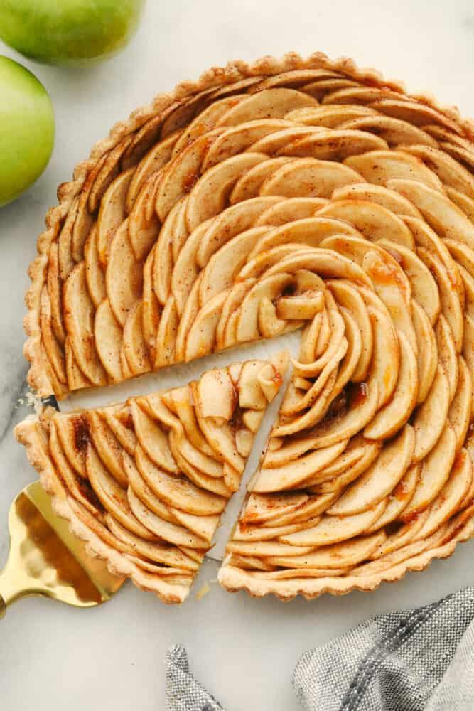 Taking a slice of apple tart.
