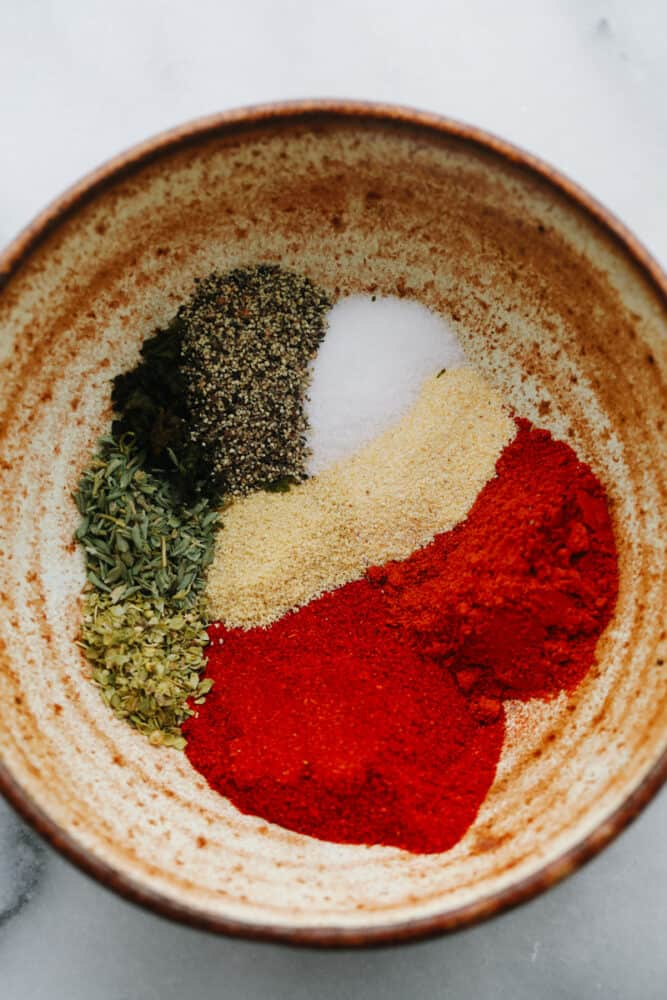 Spices ready to be mixed in a bowl.