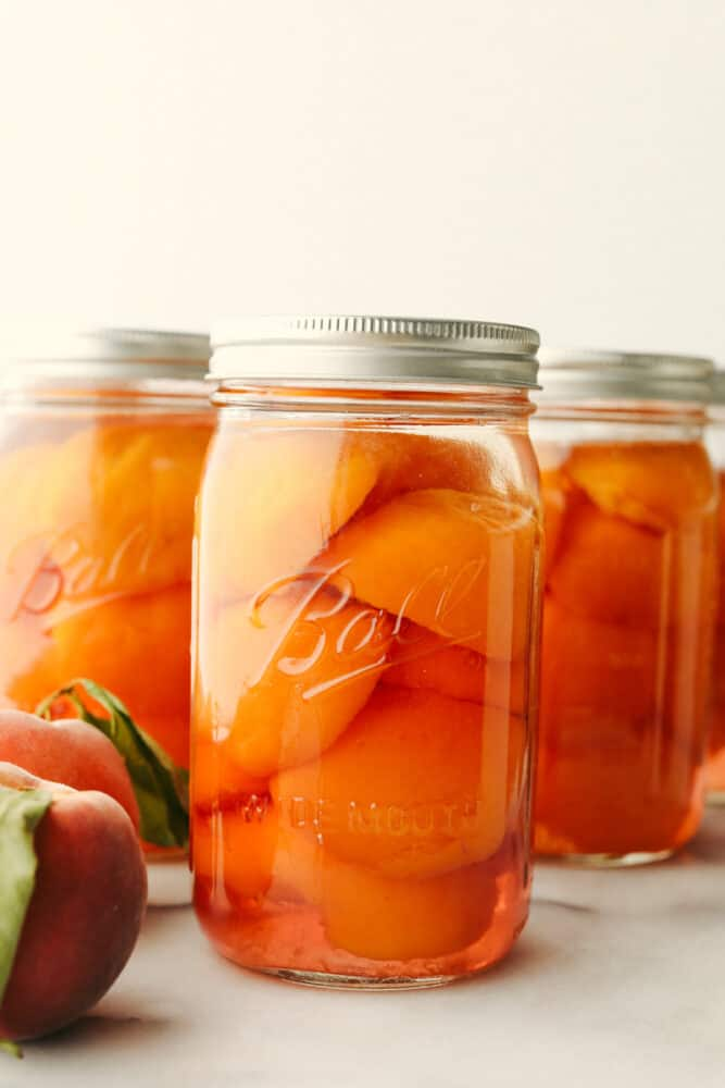 3 jars of canned peaches.