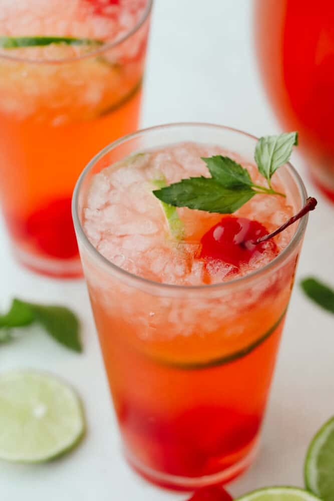 Close-up of a cherry limeade with mint garnish.